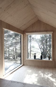 a wooden cabin with sauna and bedroom on the island of trossö, sweden.