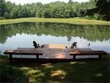 Sittin' on the dock at the bay .... oops. I mean, a dock that could overlook our pond.