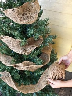 Just a simple burlap garland will spruce up any front porch Christmas tree. Just a simple burlap garland will spruce up any front porch Christmas tree.,It's the most wonderful time of the year Just. Porch Christmas Tree, Merry Little Christmas, Noel Christmas, Winter Christmas, Christmas Wreaths, Porch Tree, Burlap Christmas Decorations, Christmas Trees With Burlap, Natural Christmas Tree
