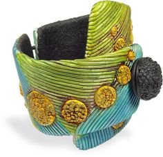 Sylvie Peraud - bracelet with buna cord hinge and closure, extruded string and rough textured trim, seen on Polymer Clay Daily