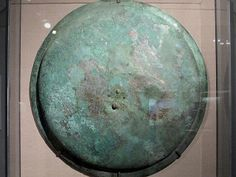 The Greek shield (hoplon) was made of wood with bronze attached. The foot soldier (hoplite) would have put his forearm through a large central bronze loop and grasped a leather strap running through small bronze loops. From about 550 -- 500 B. Greek Shield, Roman Shield, Roman Armor, Ancient Egyptian Art, Ancient Aliens, Ancient Greece, Greek History, European History, Ancient History