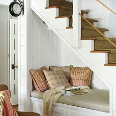 Reading Nook via Southern Living- another good under the stairs use of space idea