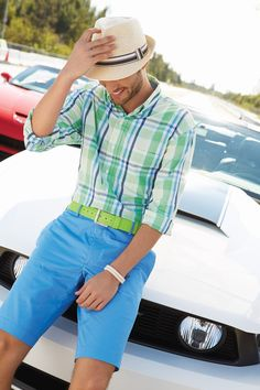 Pair a mint plaid button-down shirt with sky blue shorts for a Sunday lunch with friends.   Shop this look on Lookastic: https://lookastic.com/men/looks/long-sleeve-shirt-shorts-hat-belt-bracelet/11615   — Beige Straw Hat  — Mint Plaid Long Sleeve Shirt  — Mint Leather Belt  — White Bracelet  — Aquamarine Shorts