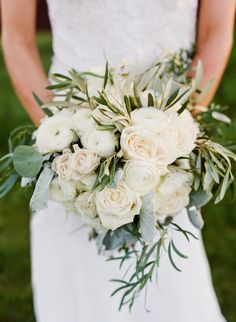 Bridal bouquet inspiration. I like dusty miller, olive leaves, double tulips, single tulips, peonies, cabbage roses, roses, ranunculus, and carnations the best for options in bouquet (with additional greenery, e.g. the olive branches used here).