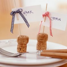 A nice idea for cork usage as name place holders   http://www.housetohome.co.uk/articles/advice/Table_setting_ideas_cork_place_card_holders_530240.html