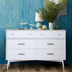 Inspiration for Malm Hack -- MCM legs installed at a slant with knobs and pulls on drawers  Mid-Century 6-Drawer Dresser - White   West Elm