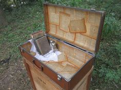 Antique book paged lined suitcase ~~via Knick of Time @ knickoftimeinteriors.blogspot.com