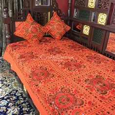 Gorgeous Flame Orange, Colour-rich fabulous Single Bedspread embroidered all over with silk threads and perfectly rounded mirror-work that catches light and enhances glorious colour. These pieces add class to a guest or family room and are meant to be passed on with time. Matching pairs of cushion-covers are included in 16.5/16.5 inches.Handmade, Indian Luxury embroidered furnishings for Living Room, Dining Room, Bedrooms, Plagrooms and Study rooms or formal table linen in silk, cotton,...