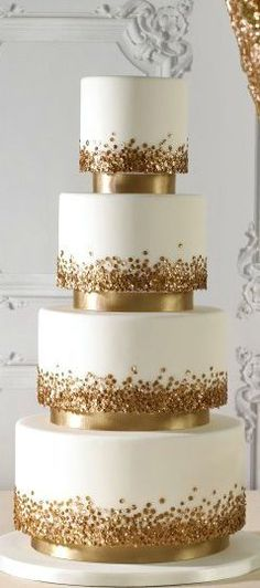 This would be FABULOUS, not as many tiers and silver/diamond sparkles #goldweddingcakes