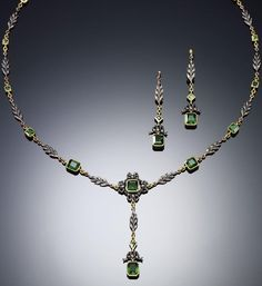 TOURMALINE DEMI-PARURE, 1890s. Of delicate stylised foliate and tied ribbon design, embellished with millegrain and collet-set step-cut tourmaline, accompanied by a pair of ear pendants en suite, length approximately 455mm, case by George Attenborough & Son, 193 Fleet St., French assay marks.