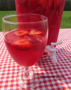 The Country Cook: Sparkling Strawberry Punch.... 1 can (12 oz) frozen Strawberry Daiquiri concentrate, thawed 1 pack of Strawberry Kool-Aid 1, 2-Liter Ginger Ale (or 7-up) 1, 1-Liter strawberry sparkling water 1 bag of Frozen Sliced Strawberries (optional)