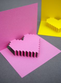 Do you have a design geek on your valentine to-make list? Check out this pixelated heart popup card tutorial from Kate at minieco, and make your own impressively cube-tastic 3D cards! I think I mig...