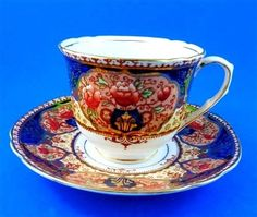 Stunning Handpainted Cobalt and Orange Melba Tea Cup and Saucer Set