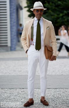 man wearing white trousers with braces