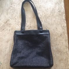 NWOT Liz Claiborne Black Leather and Woven Bag NWOT Liz Claiborne Black Leather and Woven Bag. Beautiful construction leather bottom and sides.  Simply beautiful. Liz Claiborne Bags Shoulder Bags