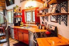 Do domku se vešla plně zařízená kuchyň, včetně myčky nádobí a elektrického sporáku s troubou.