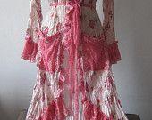 she's a sweet vintage inspired jacket in dusky rose hues.... $85.00, via Etsy.