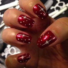 Very pretty but very simple Christmas themed nails for the holidays this year. The red base coat is a darker shade of red with a bit of shine to it, and the polka dots are silver