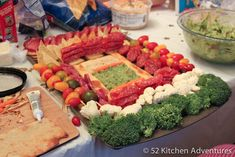 Close-up View of the Healthier Snackadium -- Skewered veggies & salami ring the stands, while guacamole & hummus take over the playing field. | 52kitchenadventures.com