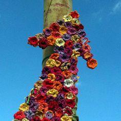 Operation Bomb Central by the BombShells Yarn Bombing, Arm Knitting, Public Art, Crochet Yarn, Urban Art, Wood Art, Crochet Patterns, Crochet Ideas, Fiber Art