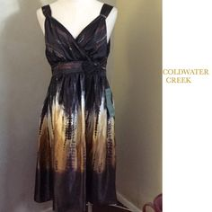 "STUNNING COLDWATER CREEK DRESS ~ NWT ✨STUNNING Coldwater Creek Brown Silky Border Print Dress ~ Crossover bodice with floral embellishment ~ This is the PERFECT dress for that Summer wedding or event ~ 100% Polyester ~ Measurements: Chest - 40"" Waist - 33"" Length - 44"" #2199  Trades or Holds ✅ Use offer option ❤️ Bundles Coldwater Creek Dresses Midi"