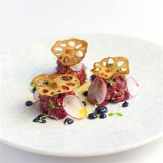 Wagyu hanger tartare, squid ink aioli and crisp lotus root