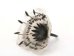 Sabrina Meyns, Black Seed Ring, 2010, handmade paper, black seeds, 1 dandelion seed, oxidized fine silver