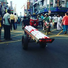Pettah still has the facets of trade from a past era. Every corner has these men pushing or pulling these cart loads of goods. #lka #Pettah #Colombo #IntCaGram