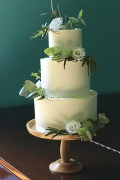 Minimal green and white buttercream wedding cake by Yolk www.cakesbyyolk.com