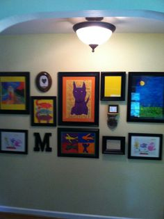 thrift store frames painted satin black with poster boards as mats a great way to