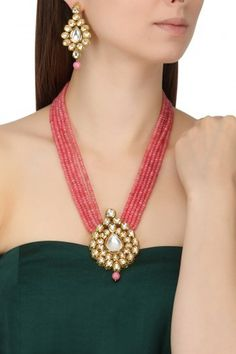 Chhavi's Jewels Featuring a gold finish pendant studded with kundan and pink multiple string beads necklace with pink drop. It is paired with gold finish kundan studded and pink drop earrings, set in metal alloy. Bead Jewellery, Pendant Jewelry, Beaded Jewelry, Beaded Necklace, Pendant Set, Jewelery, Coral Jewelry, Bridal Jewelry, Jewelry Sets