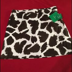 NWT Liz Claiborne Golf skirt size 10 NWT Adorable and fun Liz Claiborne Golf skirt. Size 10. Brown and White cow print. Side zip with sewn in bloomers. Super cute! Liz Claiborne Skirts