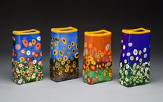Mad Art Glass Studios creates handblown art glass in San Diego.  Rina Fehrensen and Michael Maddy make colorful contemporary vases , fish and paperweights.