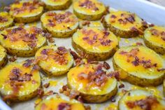 These baked potato slices topped with melted cheddar cheese and crispy, crumbled bacon make a great appetizer or side dish. This recipe is a fun take on a loaded baked potato. They're simple to make and budget friendly. Baked Potato With Cheese, Baked Potato Slices, Cheesy Mashed Potatoes, Sliced Potatoes, Loaded Potato Salad, Bacon In The Oven, Great Appetizers, Cheddar Cheese, Cheddar