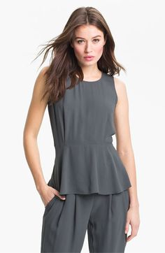 Pair this peplum top with a dark jacket and a patterned bottom. Add a colorful necklace or jewelry to make it up and add contrast. Eileen Fisher Silk Georgette Peplum Blouse (Online Exclusive) | Nordstrom