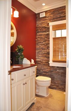 This unique bathroom was inspired by Pottery Barn! Custom vanity with granite countertop, split face stacked stone accent wall, and natural stone flooring. View the entire Van's Lumber & Custom Builders Design Gallery: Vanslumber.com/gallery.html