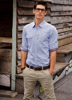 khaki pants. Shirt. Glasses.