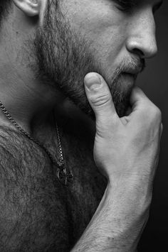 Have no idea who this is, but a love a man with chest hair and a beard!