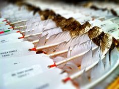 Gold touches on white feathers.  Place cards for a wedding in Vail, Colorado.  Photo by Stacy Sanchez