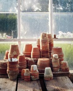 Terra-cotta pots are stacked and ready for planting.
