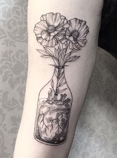 Image result for flower in bottle tattoos