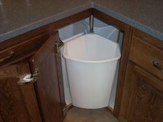 Lazy susan garbage center -this is the only way a lazy Susan makes sense!!