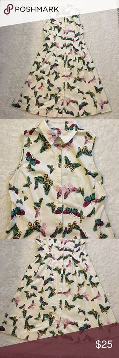 Talbots butterfly dress In like new condition. No stains or tears. Had 2 side pockets. It's a button down Dress very comfy. Measurements above. Shell: 97% cotton 3% spandex Talbots Dresses