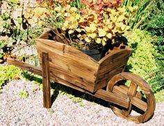 Wooden wheel barrow planter