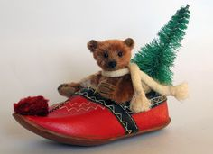 "Paula Strethill-Smith: Christmas Collection. Pere Noel is 3.5"" high miniature teddy bear. Created from genuine antique mohair in a faded cinnamon colour. He sits inside a vintage Scandinavian fur lined leather shoe along with his vintage bottle brush tree. He wears a antique wool scarf which is removable."