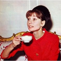 Audrey Hepburn taking tea.