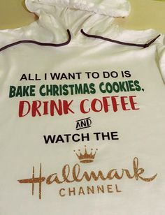 The perfect shirt for all of the Hallmark Channel fans out there - All I Want to do is Bake Chirstmas Cookies, Drink ____ and Watch the Hallmark Channel. Cute personalized shirt available in regular t-shirt, long sleeved t-shirt (LS) and hooded shirt (as shown) options and all sizes are unisex. Heat transfer vinyl applied to shirt of choice. These make PERFECT holiday gift choices for the Hallmark lover on your list.  Drink line may be personalized as follows: Drink Coffee Drink Hot…
