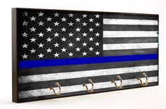 Thin blue line subdued Distressed American flag found exclusively in our Brotherhood® collection.  The bold thin blue line leaps off of the wooden surface catching everyones eye that passes by. This w