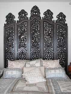 Love the idea of using a room divider for a headboard