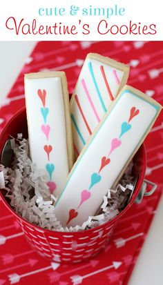 These Cute & Simple Valentine's Cookie Sticks are a perfectly adorable treat for class parties, and little gifts!